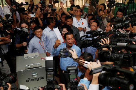 Cambodia's Prime Minister and President of the Cambodian People's Party (CPP) Hun Sen prepares to cast his vote at a polling station during a general election in Takhmao